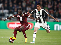 Calcio, Serie A: Torino, Juventus Stadium, 6 maggio 2017. <br /> Torino's Afriye Acquah (l) in action with Juventus' Mario Mandzukic (r) during the Italian Serie A football match between Juventus and Torino at Torino's Juventus stadium, May 6, 2017.<br /> UPDATE IMAGES PRESS/Isabella Bonotto
