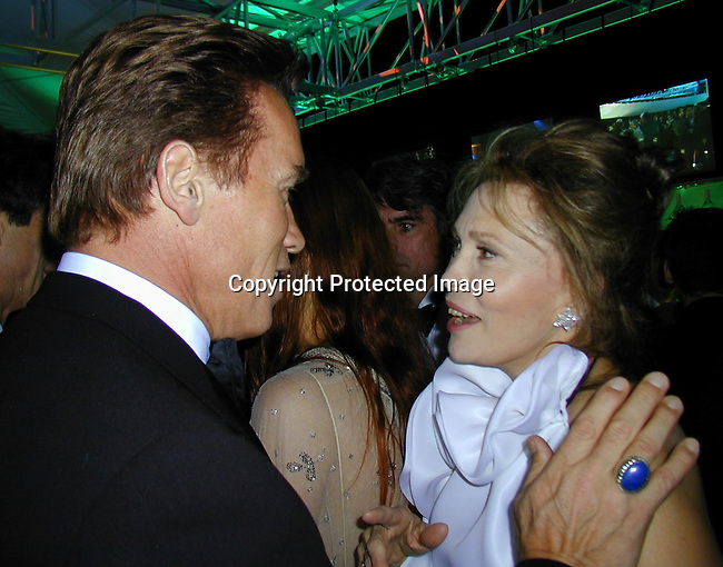 Arnold Schwarzenegger &amp; Faye Dunaway<br />2000 Vanity Fair Post Oscar Party<br />Morton's Restaurant<br />Los Angeles, California, USA<br />March 26, 2000<br />Photo by Celebrityvibe.com