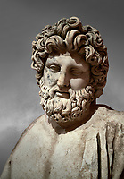 Roman statue of Asklepios. Marble. Perge. 2nd century AD. Inv no . Antalya Archaeology Museum; Turkey.  Against a grey background<br /> <br /> Asclepius was a hero and god of medicine in ancient Greek religion and mythology.