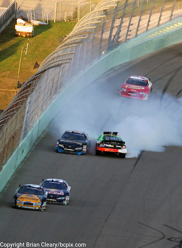 Denny Hamlin (11) and Brad Keselowski (88) get together coming off turn 4 during the Nationwide Series race at Homestead-Miami Speedway in Homestead, FL on November 21, 2009. (Photo by Brian Cleary/www.bcpix.com)