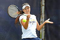 18 March 2012:  FIU's Lisa Johnson returns the ball during her doubles match against Columbia's Katarina Kovacevic and  Crystal Leung as the Columbia Lions defeated the FIU Golden Panthers, 5-2, at University Park in Miami, Florida.