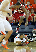 North Carolina State guard Rodney Purvis (0) jumps over Virginia guard Jontel Evans (1) during the game Saturday in Charlottesville, VA. Virginia defeated NC State 58-55.