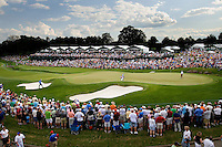 Wide angle view of the crowds gathered around the 18th green during the 2008 Wachovia Championships at Quail Hollow Country Club in Charlotte, NC.