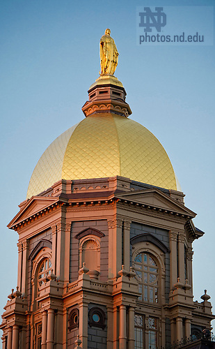 Sept. 24, 2013; Statue of Mary atop the Golden Dome at sunset. Photo by Barbara Johnston/University of Notre Dame