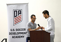 Oceanside, CA-Wednesday, June 19, 2019: US Soccer Coaches Ed Event at QLN conference center.  Jared Micklos, right, hands the microphone to <br /> Tony Lepore.