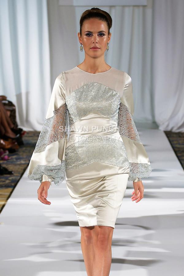 Jenia walks runway in an opal double-faced satin crepe, celadon lace detail, poet sleeve lingerie dress, from the b Michael AMERICA Couture Spring 2013 collection during Mercedes-Benz Fashion Week Spring 2013, at the Jumeirah Essex House on September 12, 2012.