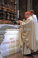 The archbishop of Krakow, Cardinal Stanislaw Dziwisz, kneels on May 3 2011 in front of the new tomb of late Pope John Paul II in Saint Peter's basilica in the Vatican. The late pope's coffin was laid to rest on May 2 in Saint Peter's basilica near the famous Pieta statue by Michelangelo, a day after the ceremony that put him on the path to sainthood.