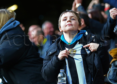 February 18th 2017,  Matchroom Stadium, Leyton, London, England, Skybet Division 2 football, Leyton Orient versus Notts County;  A Notts County fan points to his shirt badge, as he celebrates his team going 3-2 up in the 84th minute, after Jonathan Stead of Notts County scores past Leyton Orient Goalkeeper Sam Sargeant