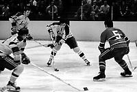 California Golden Seals Carol Vadnais, Dennis Hextal, and Norm Gerguson, Montreal Canadiens Guy Lapointe. (1971 photo by Ron Riesterer)