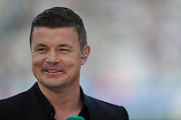 Brian O'Driscoll enjoys a joke while commentating for ITV during Match 28 of the Rugby World Cup 2015 between Ireland and Italy - 04/10/2015 - Queen Elizabeth Olympic Park, London<br /> Mandatory Credit: Rob Munro/Stewart Communications