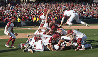 NWA Democrat-Gazette/J.T. WAMPLER The Arkansas squad celebrates beating Ole Miss Monday June 10, 2019 during the NCAA Fayetteville Super Regional at Baum-Walker Stadium in Fayetteville. Arkansas won 14-1 and will advance to the College World Series in Omaha.