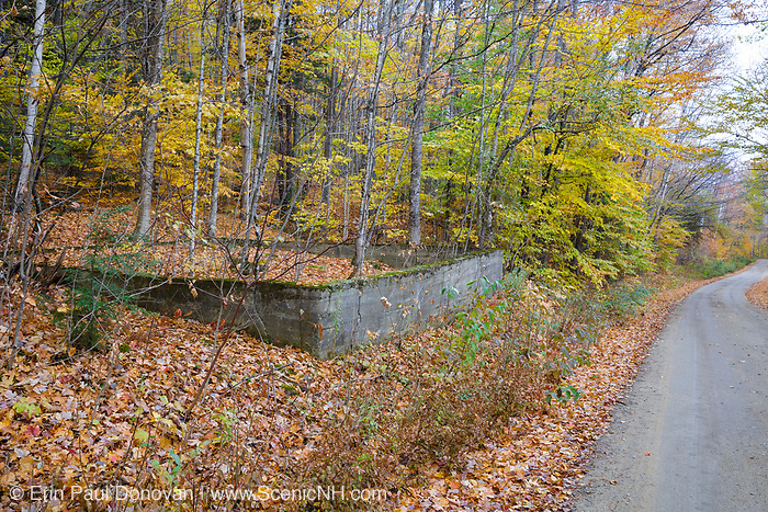 The foundation of the schoolhouse in the abandoned village of Livermore during the autumn months. This was a logging village in the late 19th and early 20th centuries along the Sawyer River Railroad in New Hampshire. Both thhe town and railroad were owned by the Saunders family.