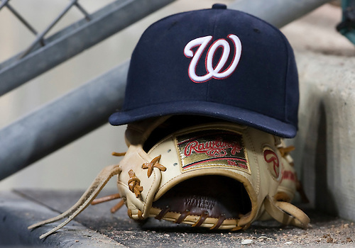 June 15, 2010: Washington Nationals third baseman Ryan Zimmerman's (#11) glove and hat on step while the Nationals are at bat in game action between the Washington Nationals and the Detroit Tigers at Comerica Park in Detroit, Michigan.  The Tigers defeated the Nationals 7-4..