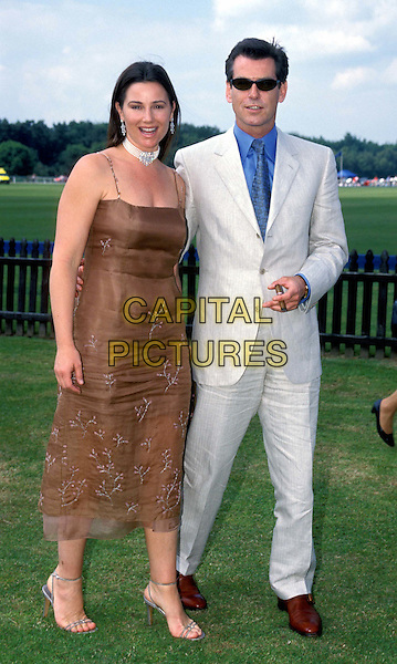 KEELY SHAYE SMITH & PIERCE BROSNAN    .Ref: 8532/1306I.celeb couple at the races, sunglasses, shades, full length, full-length.*RAW SCAN - photo will be adjusted for publication*.www.capitalpictures.com.sales@capitalpictures.com.© Capital Pictures