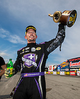 Sep 25, 2016; Madison, IL, USA; NHRA funny car driver Jack Beckman celebrates after winning the Midwest Nationals at Gateway Motorsports Park. Mandatory Credit: Mark J. Rebilas-USA TODAY Sports