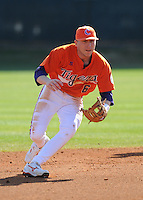 Clemson shortstop Stan Widmann (6) picks up a grounder during batting practice prior to a game between the Charlotte 49ers and Clemson Tigers Feb. 20, 2009, at Doug Kingsmore Stadium in Clemson, S.C. (Photo by: Tom Priddy/Four Seam Images)