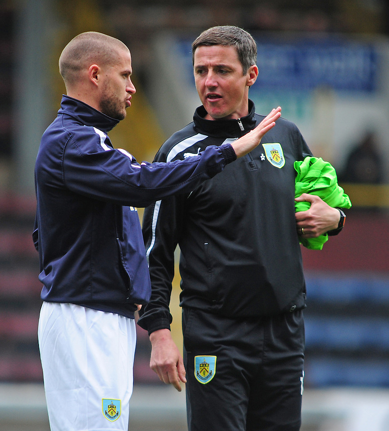 Burnley's Michael Kightly, left, talks to Burnley's First Team Coach Tony Loughlan during the pre-match warm-up <br /> <br /> Photo by Chris Vaughan/CameraSport<br /> <br /> Football - The Football League Sky Bet Championship - Burnley v Middlesbrough - Saturday 12th April 2014 - Turf Moor - Burnley<br /> <br /> &copy; CameraSport - 43 Linden Ave. Countesthorpe. Leicester. England. LE8 5PG - Tel: +44 (0) 116 277 4147 - admin@camerasport.com - www.camerasport.com