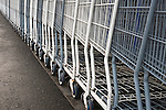 Rows of shopping carts outised store patterns of metal