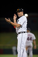 Mesa Solar Sox hitting coach Mike Hessman (27), of the Detroit Tigers organization, coaches first base during a game against the Glendale Desert Dogs on October 16, 2017 at Sloan Park in Mesa, Arizona. The Desert Dogs defeated the Solar Sox 2-0.  (Zachary Lucy/Four Seam Images)