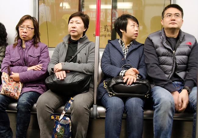 Hong Kong urban scene - commuters riding in the MRT subway