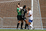 30 August 2009: Duke's Tara Campbell (left) catches the ball under pressure from Central Florida's Christina Petrucco (22). The Duke University Blue Devils lost 3-2 to the University of Central Florida Knights at Fetzer Field in Chapel Hill, North Carolina in an NCAA Division I Women's college soccer game.