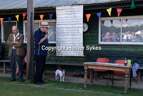 Ebernoe Horn Fair West Sussex UK. Annual cricket match on Ebernoe village Common. The Horns from the lamb roasted for the players lunch are presented to the player from the winning side who scores the most runs. Followed by the singing of the Horn Fair Song.<br />
