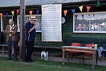 Ebernoe Horn Fair West Sussex UK. Annual cricket match on Ebernoe village Common. The Horns from the lamb roasted for the players lunch are presented to the player from the winning side who scores the most runs. Followed by the singing of the Horn Fair Song.<br /> <br /> The Horn Fair Song is an old folk song that was re-discovered in 1950 in a radio broadcast by a local farmer Wilfred Moorish which he introduced into the Horn Fair. At this time a local man Tom Stemp, the aged 75yrs  recalled an Ebernoe woodman David Baker singing this song, and he had died in 1943 aged 80yrs. The song is sung after the presentation.