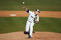 Wingate Bulldogs relief pitcher Sawyer Lee (14) delivers a pitch to the plate against the Concord Mountain Lions at Ron Christopher Stadium on February 2, 2020 in Wingate, North Carolina. The Mountain Lions defeated the Bulldogs 12-11. (Brian Westerholt/Four Seam Images)