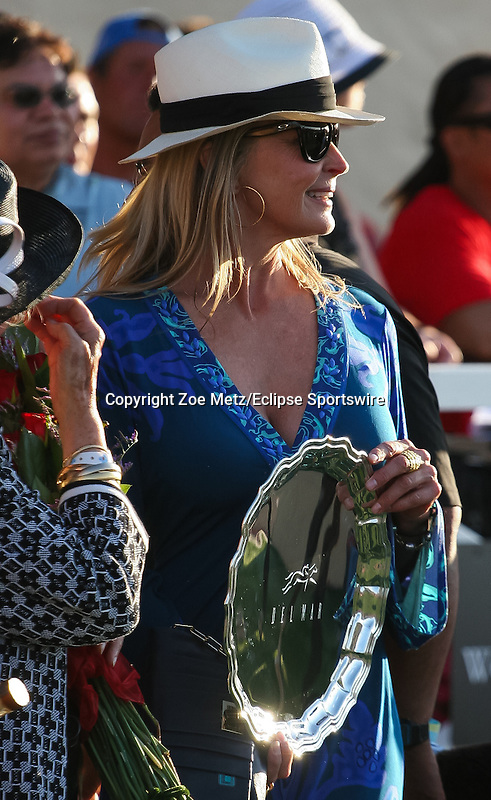 Bo Derek presents a winner's trophy on opening day at Del Mar Turf Club in Del Mar, California on July 18, 2012
