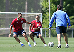 Head coach Bruce Arena (r) starts a drill with Clint Dempsey (l) and Landon Donovan (center) on Tuesday, May 16th, 2006 at SAS Soccer Park in Cary, North Carolina. The United States Men's National Soccer Team held a training session as part of their preparations for the upcoming 2006 FIFA World Cup Finals being held in Germany.