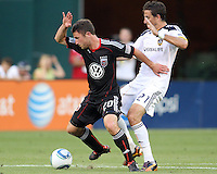 Stephen King #20 of D.C. United shields the ball from Alan Gordon #21 of the Los Angeles Galaxy during an MLS match at RFK Stadium on July 18 2010, in Washington D.C. Galaxy won 2-1.