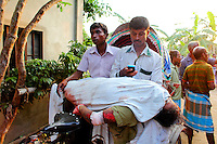 Two men carry a dead woman on a bicycle rickshaw from the scene of the collapsed Rana Plaza complex in Savar near Dhaka...The 8 storey building, which housed a number of garment factories employing over 3,000 workers, collapsed on 24 April 2013. By 29 April, at least 380 were known to have died while hundreds remained missing. Workers who were worried about going to work in the building when they noticed cracks in the walls were told not to worry by the building's owner, Mohammed Sohel Rana, who is a member of the ruling Awami League's youth front. He fled his home and tried to escape to neighbouring India after the building collapsed but was caught by police and brought back to Dhaka. Some of the factories working in the Rana Plaza building produce cheap clothes for various European retailers including Primark in the UK and Mango, a Spanish label. ... /Felix Features