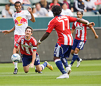 Chivas USA midfielder Sacha Kljestan (16) is taken down from behind. Chivas USA defeated the Red Bulls of New York 2-0 at Home Depot Center stadium in Carson, California April 10, 2010.  .