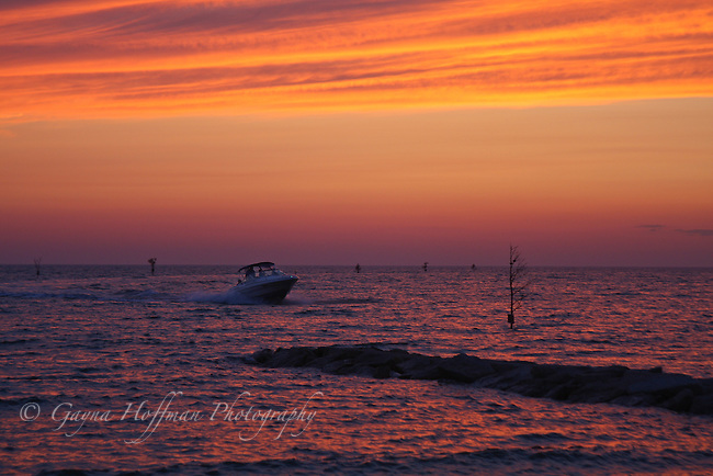 Boat returning to the dock at sunset. Rock Harbor, Orleans, MA