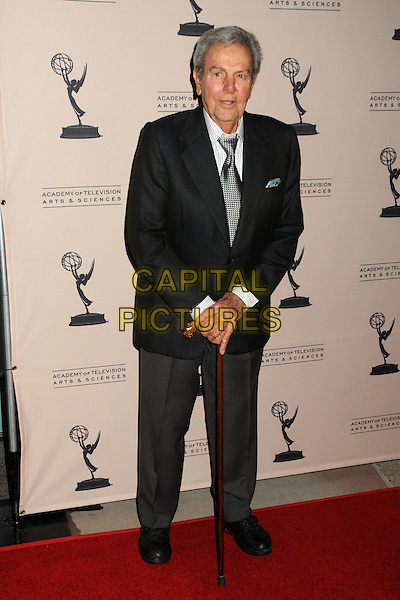 "MIKE CONNORS.""Primetime TV Crimefighters"" Presented by the Academy of Television Arts & Sciences held at the Leonard H. Goldenson Theatre, North Hollywood, California, USA..November 1st, 2010.full length grey gray tie trousers cane walking stick black white.CAP/ADM/BP.©Byron Purvis/AdMedia/Capital Pictures."