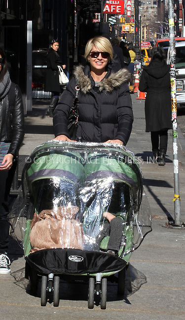 WWW.ACEPIXS.COM . . . . .  ....February 27 2012, New York City....Actress Jennifer Elfman pushes her kids around Soho on February 27 2012 in New York City....Please byline: Zelig Shaul - ACE PICTURES.... *** ***..Ace Pictures, Inc:  ..Philip Vaughan (212) 243-8787 or (646) 769 0430..e-mail: info@acepixs.com..web: http://www.acepixs.com