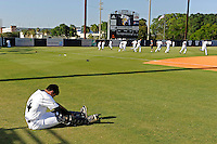 5 May 2012:  FIU catcher Aramis Garcia (24) stretches while teammates run sprints prior to the game.  The FIU Golden Panthers defeated the Middle Tennessee State University Blue Raiders, 12-6, at University Park Stadium in Miami, Florida.