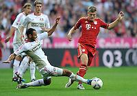FUSSBALL   1. BUNDESLIGA  SAISON 2011/2012   7. Spieltag FC Bayern Muenchen - Bayer 04 Leverkusen          24.09.2011 Oemer Toprak (li, Bayer 04 Leverkusen) gegen Toni Kroos (re, FC Bayern Muenchen)