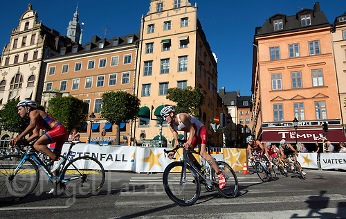 25 AUG 2013 - STOCKHOLM, SWE -  Andrew Yorke (CAN) (second from left, in white and red) of Canada rounds a corner during the elite men's ITU 2013 World Triathlon Series round in Gamla Stan in Stockholm, Sweden (PHOTO COPYRIGHT © 2013 NIGEL FARROW, ALL RIGHTS RESERVED)