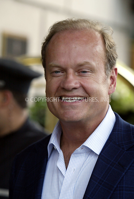 Actor Kelsey Grammer and his wife Camille returning to their mid-town hotel following a stroll in Central Park, New York City. Grammer and the rest of the cast of the hit TV show 'Frasier' are in town to promote the final show which airs this week. New York City. May 11 2004. Please byline: ACE Pictures.   ..*PAY-PER-USE*      ....IMPORTANT: Please note that our old trade name, NEW YORK PHOTO PRESS (NYPP), is replaced by our new name, ACE PICTURES. New York Photo Press and ACE Pictures are owned by All Celebrity Entertainment, Inc.......All Celebrity Entertainment, Inc:  ..contact: Alecsey Boldeskul (646) 267-6913 ..Philip Vaughan (646) 769-0430..e-mail: info@nyphotopress.com