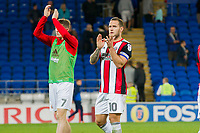 Billy Sharp of Sheffield United claps the travelling fans at full time of the Sky Bet Championship match between Cardiff City and Sheffield United at Cardiff City Stadium, Cardiff, Wales on 15 August 2017. Photo by Mark  Hawkins / PRiME Media Images.