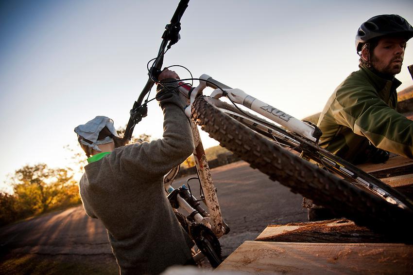 Mountain bikers unload bikes from their truck while biking in Copper Harbor Michigan Michigan's Upper Peninsula.