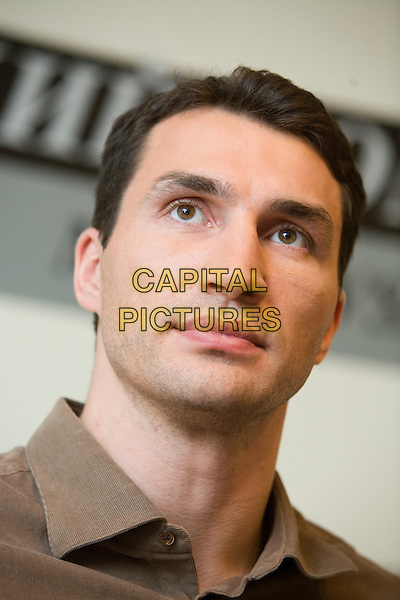Wladimir Klitschko.Press conference in the newspaper the Moscow member of the Komsomol, Russia..November 23rd, 2006.headshot portrait brown shirt .CAP/PER/AM.©AM/PersonaStars/CapitalPictures