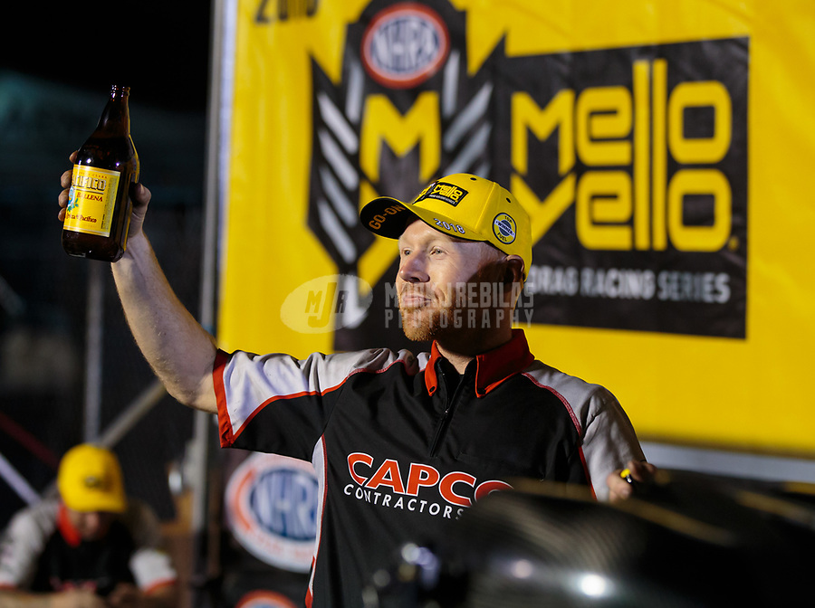 Nov 11, 2018; Pomona, CA, USA; Crew members for NHRA top fuel driver Steve Torrence celebrates after winning the Auto Club Finals at Auto Club Raceway. Torrence swept all six of the countdown to the championship races to clinch the world championship. Mandatory Credit: Mark J. Rebilas-USA TODAY Sports