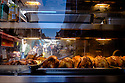 Paris, France. 09.05.2015. Rotisserie Chicken in a warming cabinet, Rue Mouffetarde, Paris, France. Photograph © Jane Hobson.
