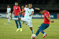 PEREIRA - COLOMBIA, 24-01-2020: Nicolas Diaz de Chile disputa el balón con Marcelo Herrera de Argentina durante partido entre Chile y Argentina por la fecha 3, grupo A, del CONMEBOL Preolímpico Colombia 2020 jugado en el estadio Hernán Ramírez Villegas de Pereira, Colombia. / Nicolas Diaz of Chile fights the ball with Marcelo Herrera of Argentina during the match between Chile and Argentina for the date 3, group A, for the CONMEBOL Pre-Olympic Tournament Colombia 2020 played at Hernan Ramirez Villegas stadium in Pereira, Colombia. Photos: VizzorImage / Julian Medina / Cont
