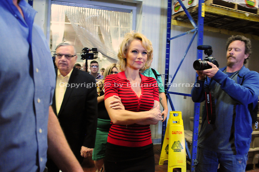 Phoenix, Arizona -- Actress Pamela Anderson is given a tour of the Lower Buckeye County Jail facilities where food is stored and meals are prepared. Anderson visited the jail in Phoenix, Arizona to promote all-vegetarian meals for inmates. Anderson visited the detention facilities as a spokesperson for People for the Ethical Treatment of Animals (PETA). The actress was given a tour of the facilities by Maricopa County Sheriff Joe Arpaio.  Anderson was accompanied by PETA Senior Vice President Dan Mathews. Photo by Eduardo Barraza © 2015