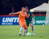 Sky Blue FC defender Meghan Schnur (12) and Saint Louis Athletica defender Nikki Cross (19) during a WPS match at Anheuser Busch Soccer Park, in St. Louis, MO, July 22 2009. Athletica won the match 1-0.