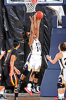 25 November 2011:  FIU guard Kamika Idom (14) and Maryland guard-forward Tianna Hawkins (21) go up after a rebound in the second half as the University of Maryland Terrapins defeated the FIU Golden Panthers, 84-52, at the U.S. Century Bank Arena in Miami, Florida.