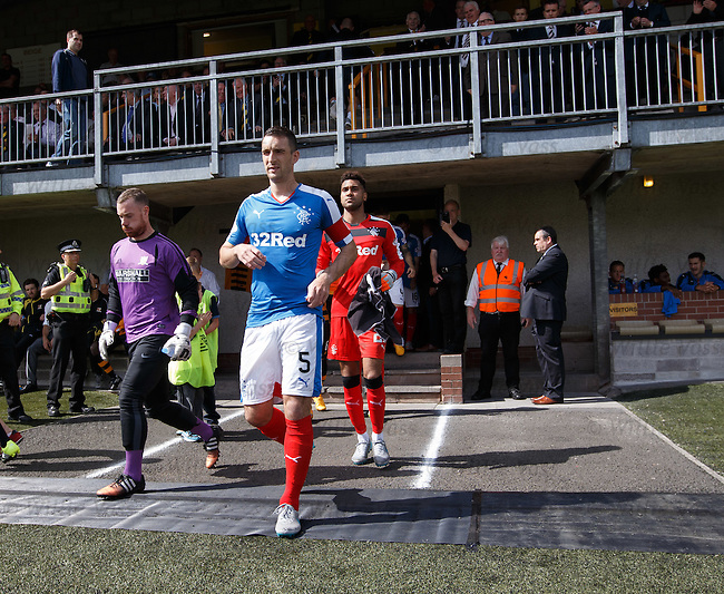 Lee Wallace leads out the Rangers team